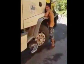 Bêbado é flagrado batendo uma atrás do caminhão